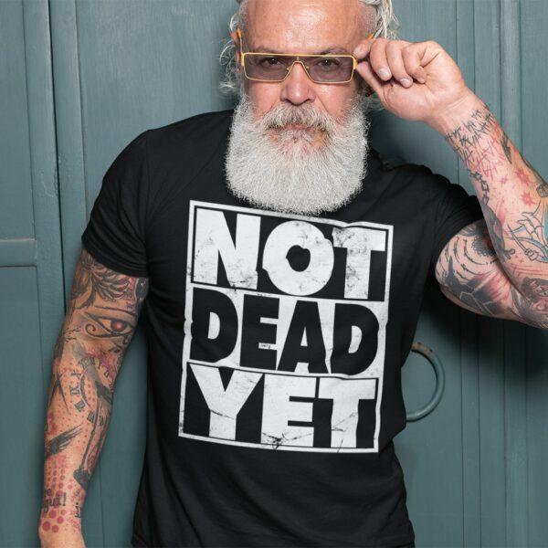 Man wearing a Not Dead Yet t-shirt